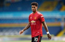 Soccer-Rashford back at United's training base after shoulder surgery