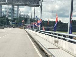 Jalur Gemilang raised along Johor Causeway in keeping with National Month tradition