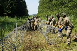 Lithuania says will complete Belarus border fence by Sept 2022