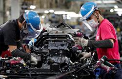 Japan's private-sector activity hit by Covid-19 surge