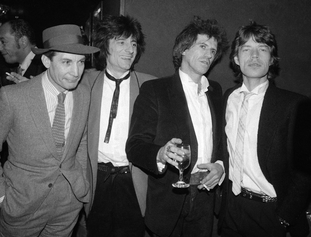 Members of the Rolling Stones (from left) Charlie Watts, Ron Wood, Keith Richards, and Mick Jagger appear at a party celebrating the opening of their film 'Let's Spend The Night Together', in New York on Jan 18, 1983. Photo: AP