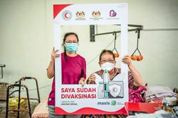 Telco ties up with NGO to get vaccination efforts moving