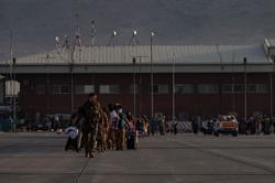 Australia urges people to leave Kabul airport area on terrorism threat