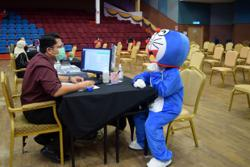 'Doraemon' cheers up frontliners, public at Kuala Nerus vaccination centre