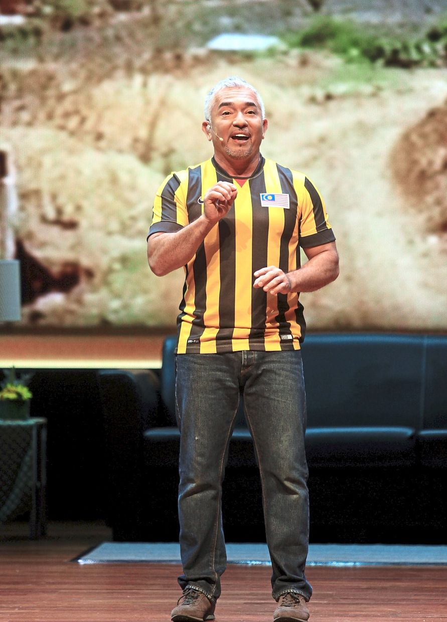 Millan at a live show in KLCC in 2015. He likens a visit to his Dog Psychology Center to the experience people get when they visit Malaysia: 'They've got to experience the land, the people and the culture,' he says.