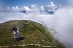 WATCH: French graffiti artist paints boy blowing 'clouds' on Swiss Alps