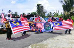Bachok man adorns 4X4 vehicle with 64 Jalur Gemilang to celebrate National Day