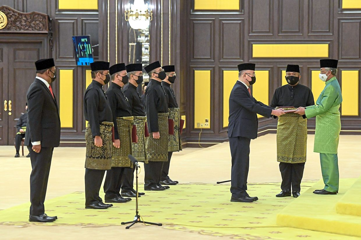 Assuming responsibilities: Sultan Abdullah presenting Wee with his instrument of appointment during the swearing-in ceremony at Istana Negara, Kuala Lumpur. — Bernama