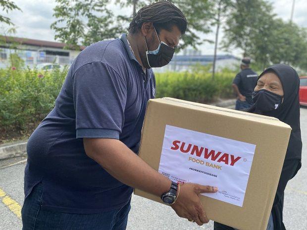 #SunwayforGood Food Bank delivering aid to a recipient at PPR Desa Mentari