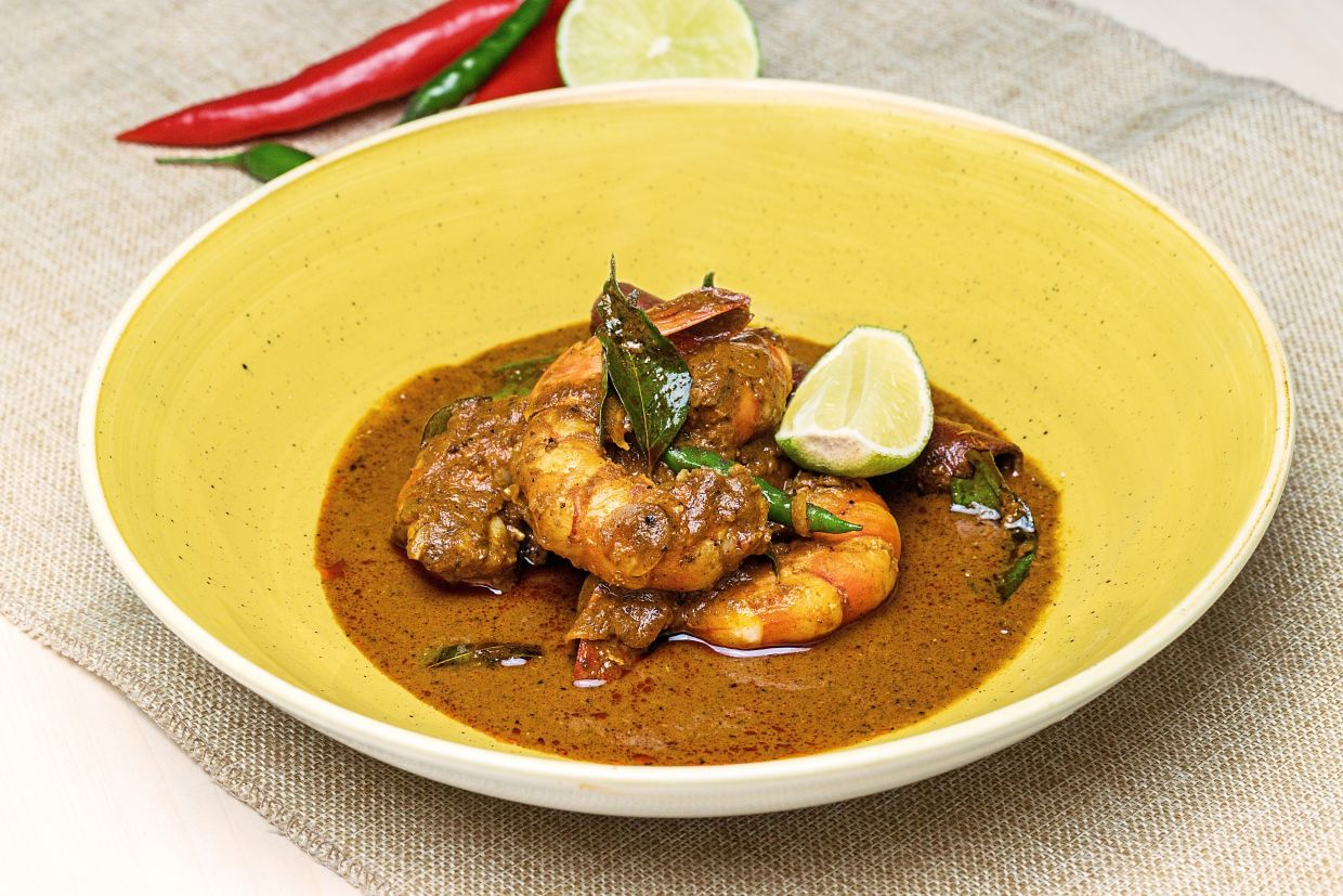 Expect to learn how to make amazing dishes like this devilled prawn curry!