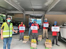 Developer gives food packs to 8,000 workers at construction sites