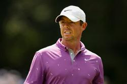 Golf-McIlroy wants unruly fans held to higher standard