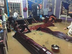 Heavy rain triggers floods in Johor and Sabah