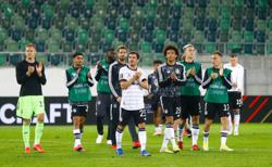 Soccer-Germany grind out 2-0 qualifying win over Liechtenstein