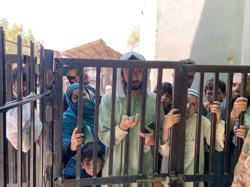 At an Afghanistan border crossing, people face uncertainty and a long wait