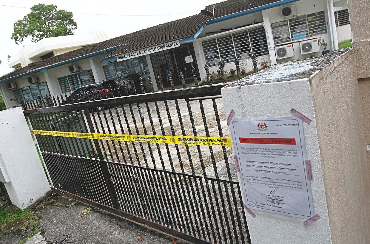 A closure notice pasted on the gate of the nursing and rehabilitation centre in Pulau Tikus, Penang.