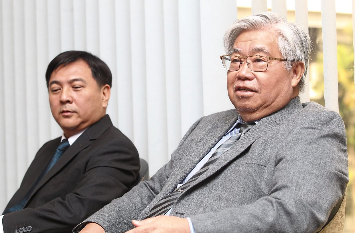 Potential turnaround: A file picture showing Tan (left) and Lee during a press conference. Analysts say funds are looking for a turnaround under the stewardship of Tan.