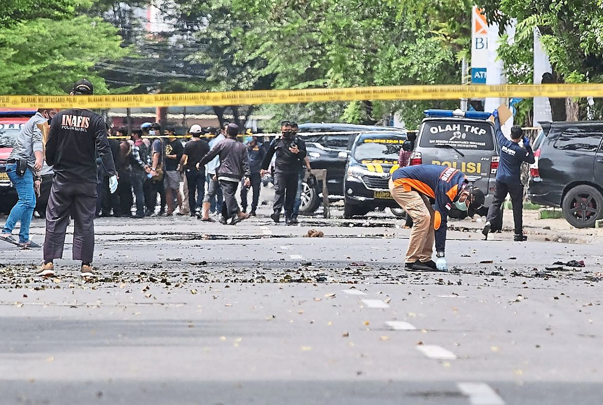 Aftermath: Police inspecting the area near a church attacked by JAD fighters in Makassar in March this year. — AP