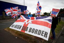 Britain warns of 'cold mistrust' if EU does not move on Northern Ireland trade