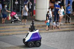 Autonomous robots check on bad behaviour in Singapore's heartland