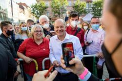 Boosted by surge in polls, Germany's Scholz bets on coalition with Greens
