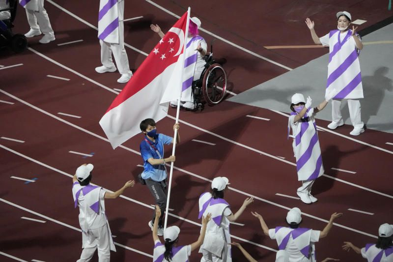 The Singapore flag enters the stadium during the closing ceremony for the 2020 Paralympics at the National Stadium in Tokyo, on Sunday, Sept. 5, 2021. - AP