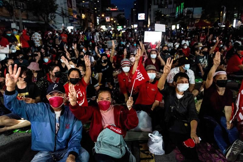 Anti-government protesters give a three finger salute during a demonstration in Bangkok on September 5, 2021, as activists call for the resignation of Thailand's Prime Minister Prayut Chan-O-Cha over the government's handling of the Covid-19 coronavirus crisis. - AFP