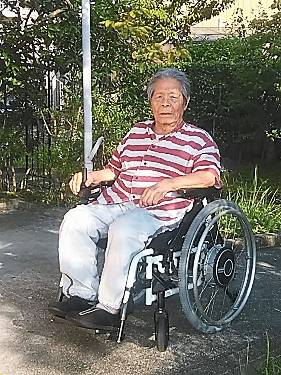 Kondo, who competed in wheelchair basketball and archery during the Tokyo 1964 Paralympic Games, in his neighbourhood in Aki, Kochi prefecture. Photo: Keiko Higuchi/Courtesy of Hideo Kondo/AFP