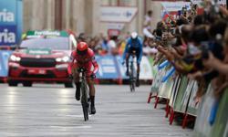 Cycling-Roglic claims Vuelta hat-trick