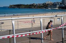 Australia faces renewed taper debate