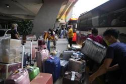 Metro Manila curbs eased; local lockdowns seen as stricter