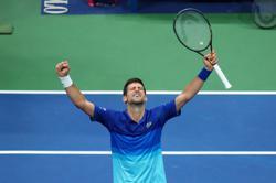 Tennis-Djokovic overcomes flat start to reach U.S. Open quarter-finals