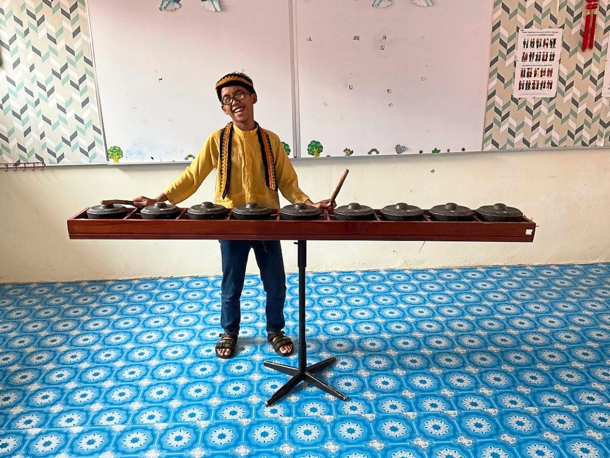 Putra suffers from visual impairment but that hasn't stopped him from playing the kulintang.
