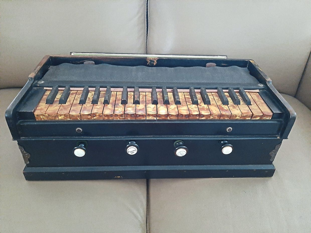 The writer's mother's antique harmonium was bought in the 1940s.