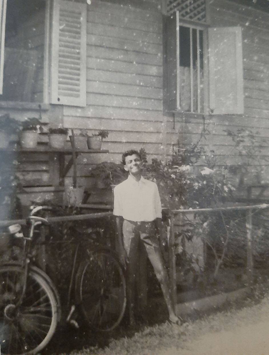 The writer posing beside his house in the government quarters in Raub, Pahang, in 1965.
