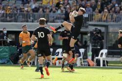 Rugby-All Black Barrett 'rapt' after red card dismissed