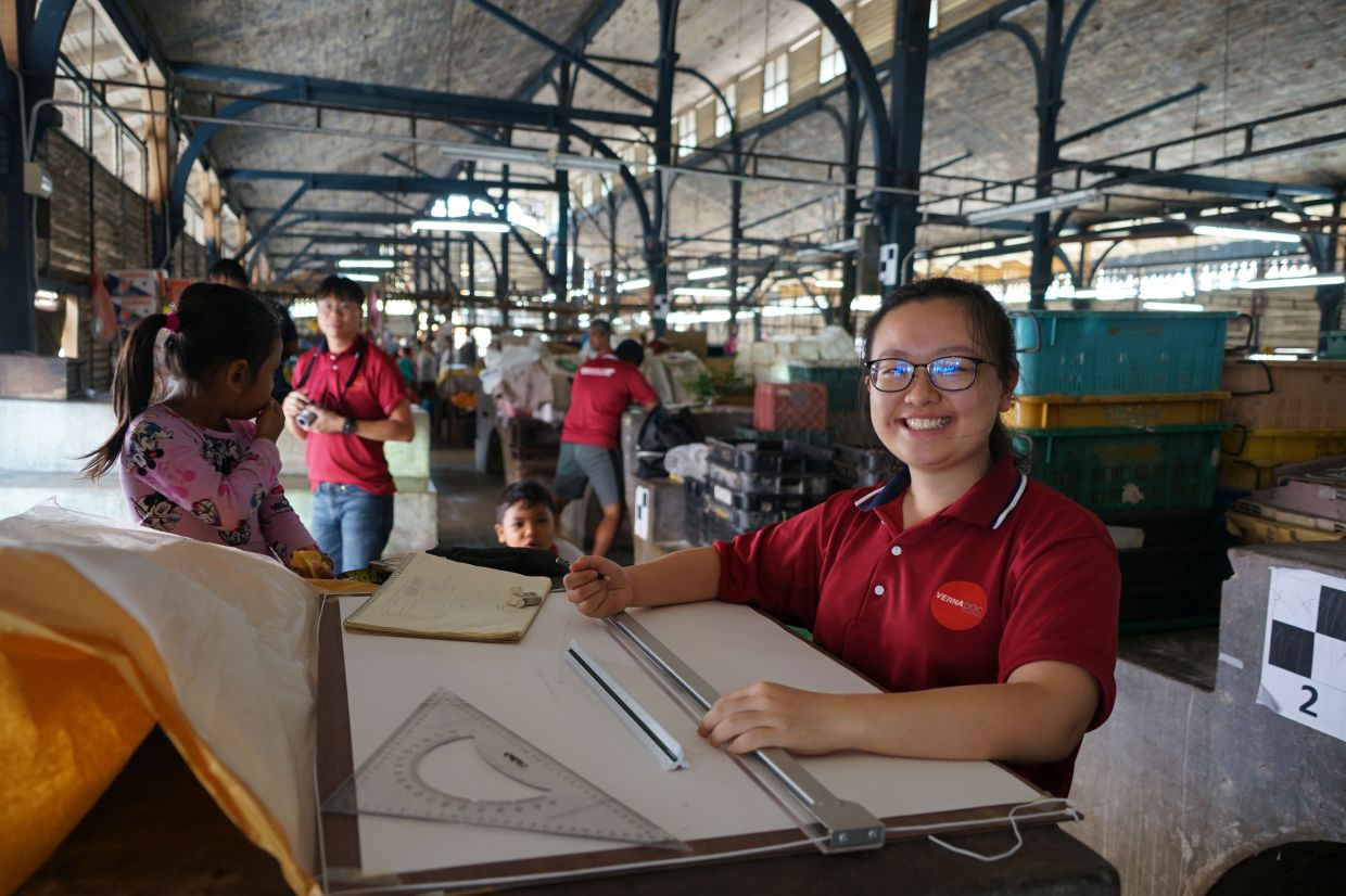 Students at work on the Vernadoc Taiping Market community project.