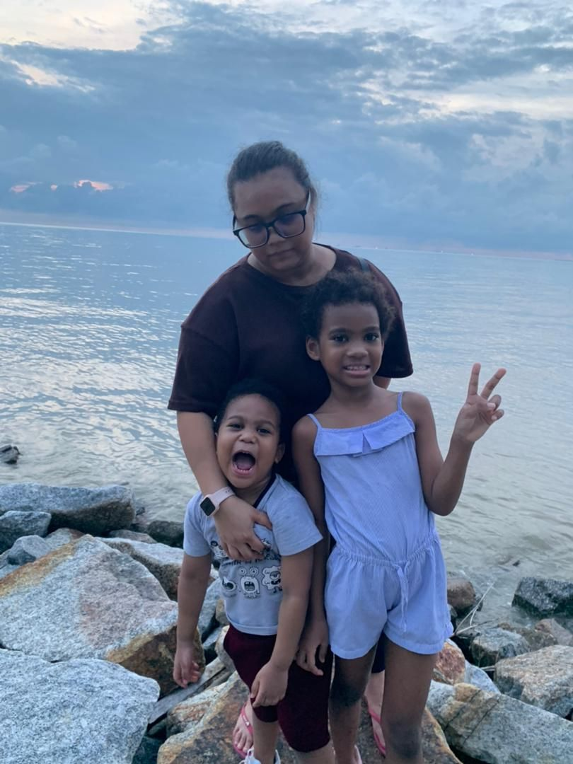 Myra with her two children, who will now both be Malaysian. She's been applying for her daughter's citizenship for the past eight years. Photo: MYRA ELIZA MOHD DANIL
