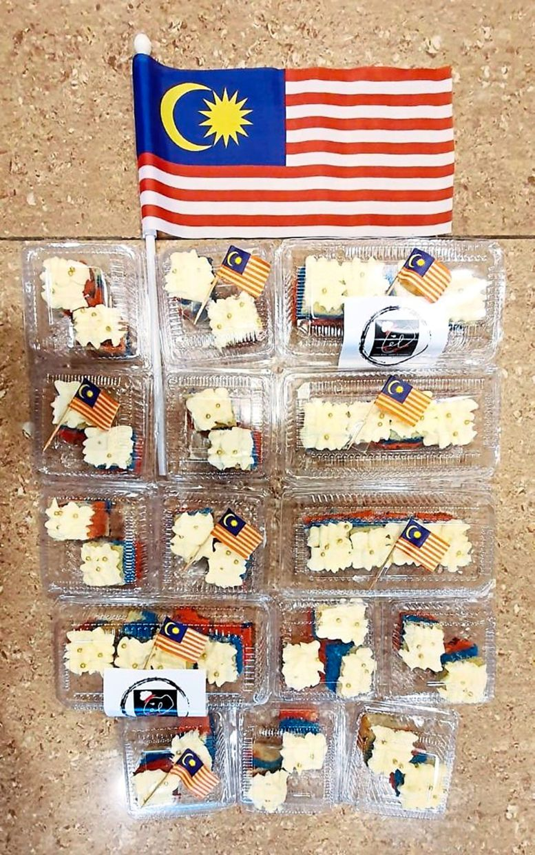 Packets of Merdeka Theme Cake that were given out to food delivery riders as a show of thanks.
