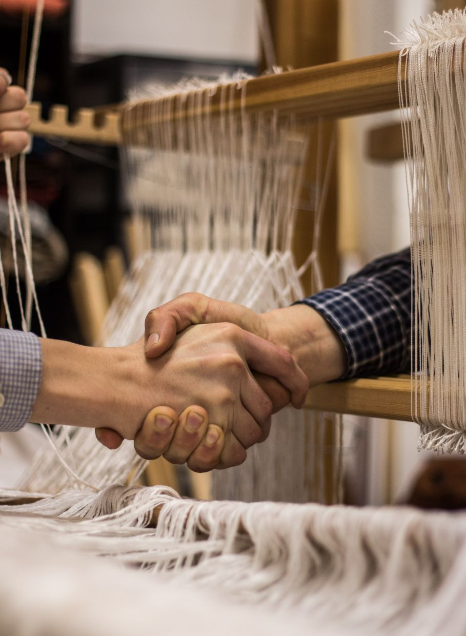 Pannepacker packs up her loom, her yarns, two stools, her sign, hand sanitiser, and masks and sets up somewhere folks are likely to walk by. She greets those whose eyes meet hers, asks how they've been. She answers the questions of the curious, and gives people a chance to talk about anything they wish. Photo: Unsplash/Matthew Lancasater