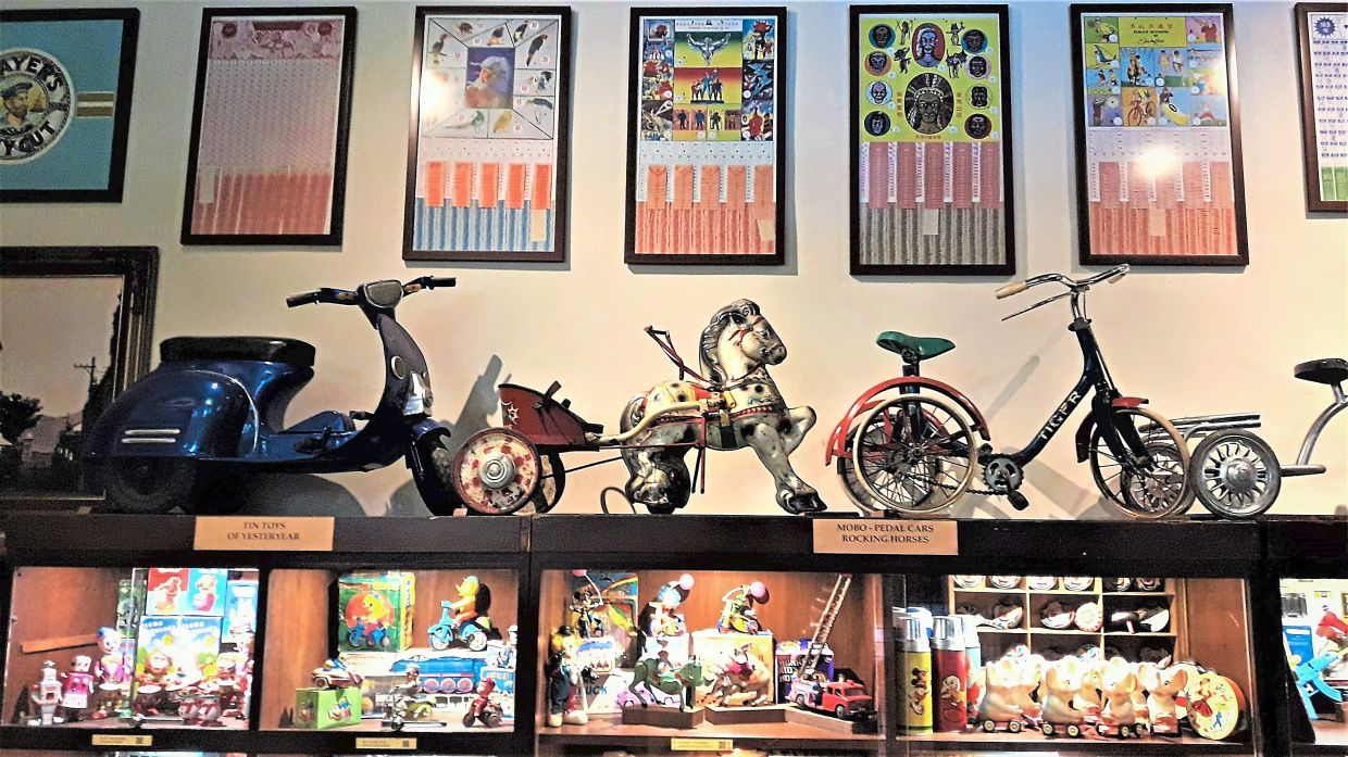 A section of the Made In Ipoh gallery-museum featuring vintage pedal cars, tin-toys and games.