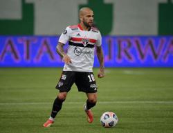Soccer-Alves boycotts Sao Paulo over club debt