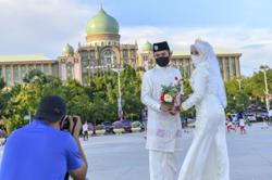 Newlyweds thrilled to snap pictures in Putrajaya as inter-district travel allowed in Klang Valley