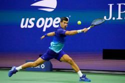 Tennis-Djokovic wins US Open semi-final, keeps quest for calendar Grand Slam on track