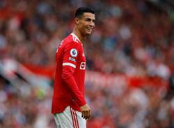 Soccer-Ronaldo takes United joint top with Chelsea, City win and Spurs slump