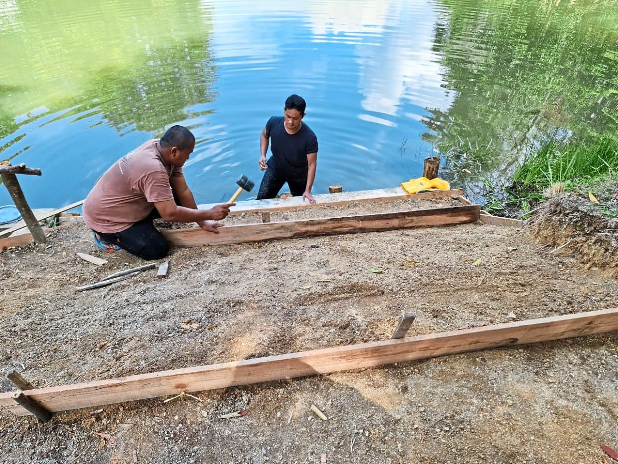 The residents also worked together to build steps that would lead to a picturesque spot at the lake.