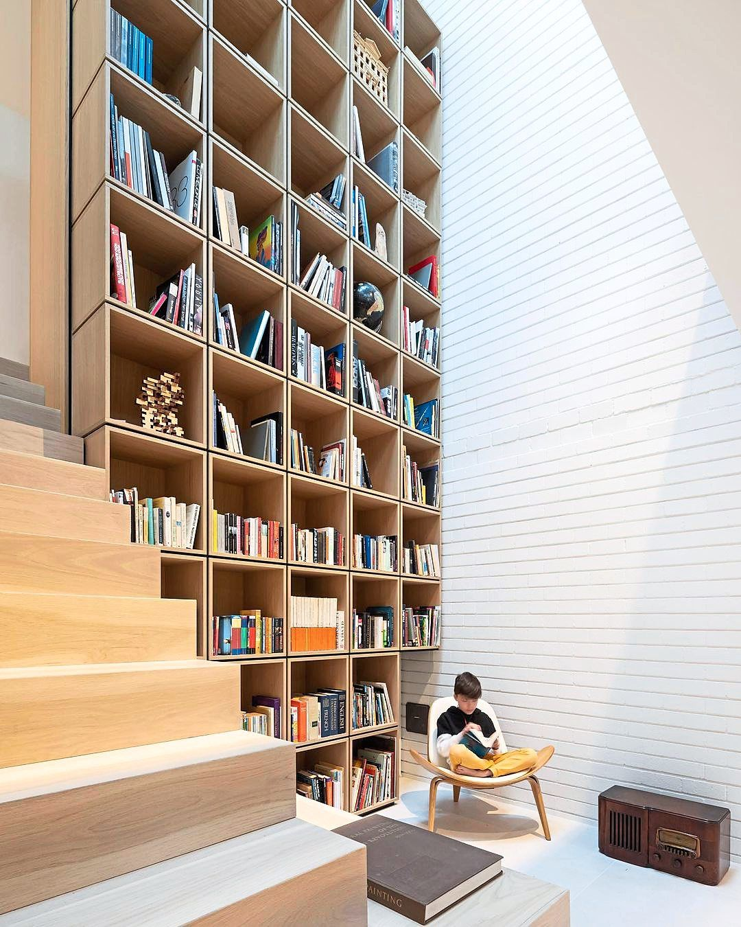 Canadian firm RSAAW designed a two-storey library for the renovation of a Vancouver home. Photo: rsa.aw/Instagram