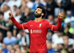 Soccer-Salah joins 100 club as Liverpool win at Leeds in match marred by Elliott injury