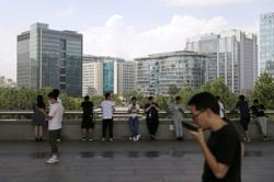 In fresh regulatory move, China tells tech giants to stop blocking rivals' links