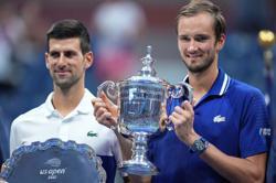 Tennis-Djokovic denied as stars are born on New York stage
